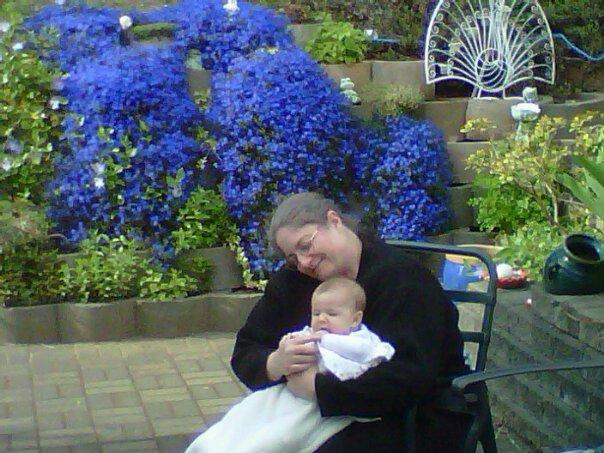 Grama Angela with Brooklyn on the Patio